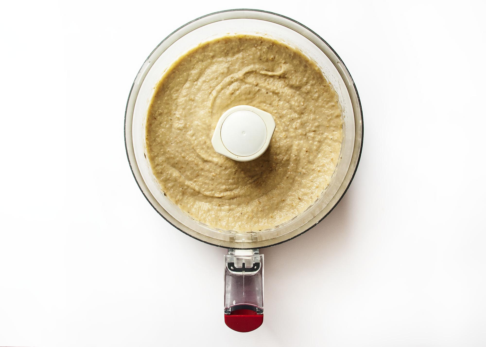 Baba Ghanoush - This creamy, smoky eggplant dip lightened with a bit of mayonnaise will have you going back for more.   justalittlebitofbacon.com