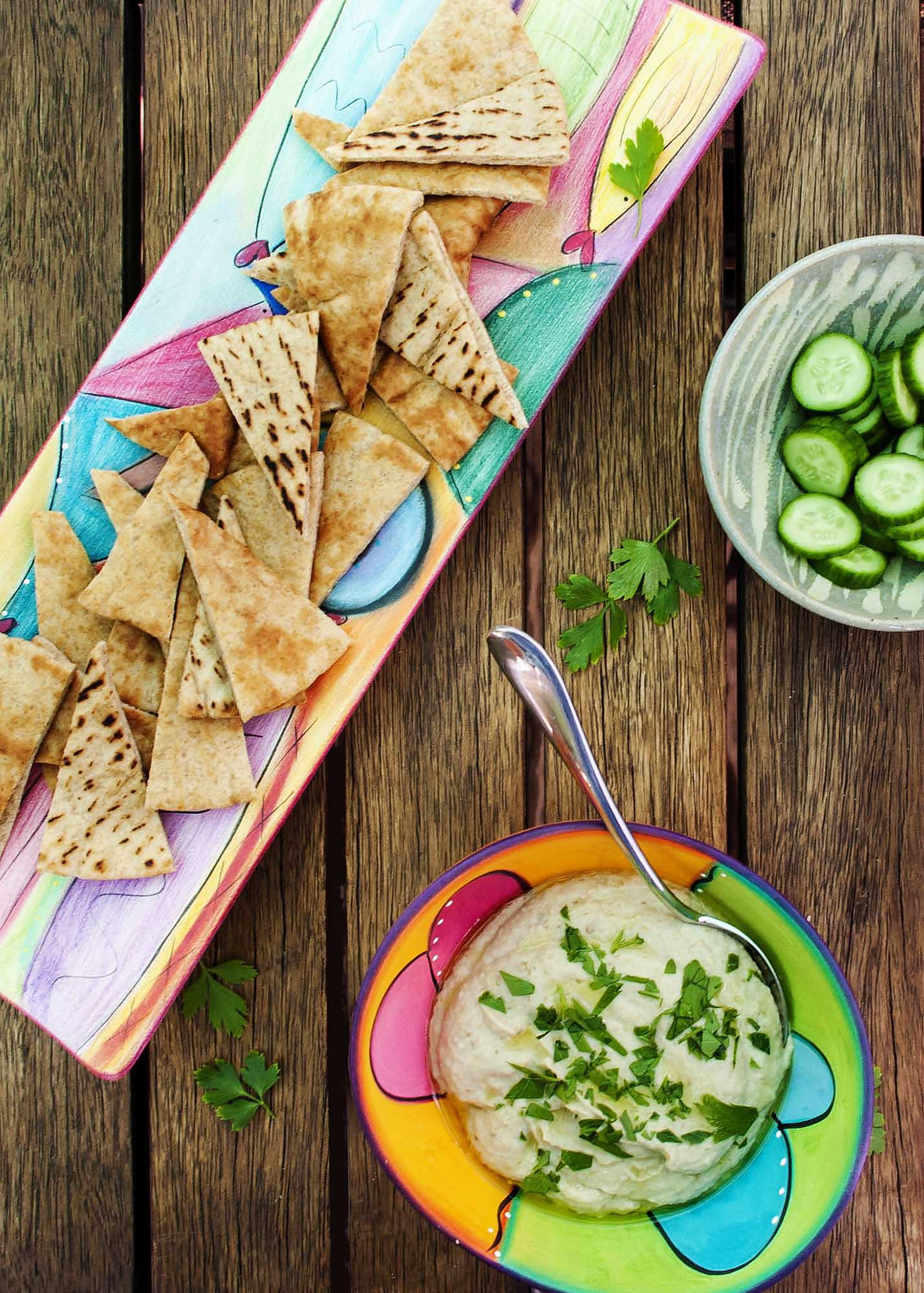 Baba Ghanoush - This creamy, smoky eggplant dip lightened with a bit of mayonnaise will have you going back for more. | justalittlebitofbacon.com