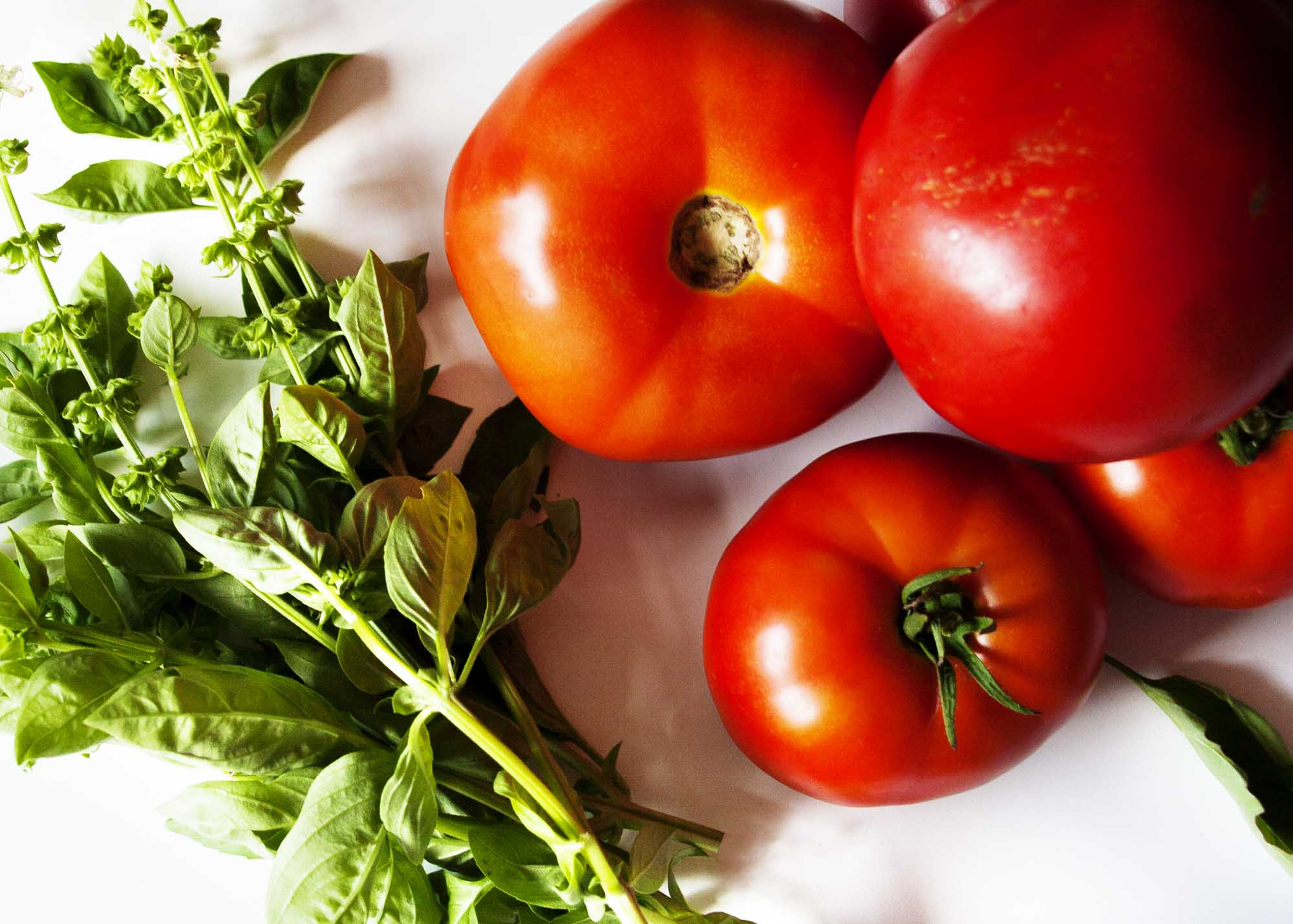 Tomato, Basil Caprese Salad - This salad is a example of taking the freshest ingredients using them simply and producing incredible results. | justalittlebitofbacon.com