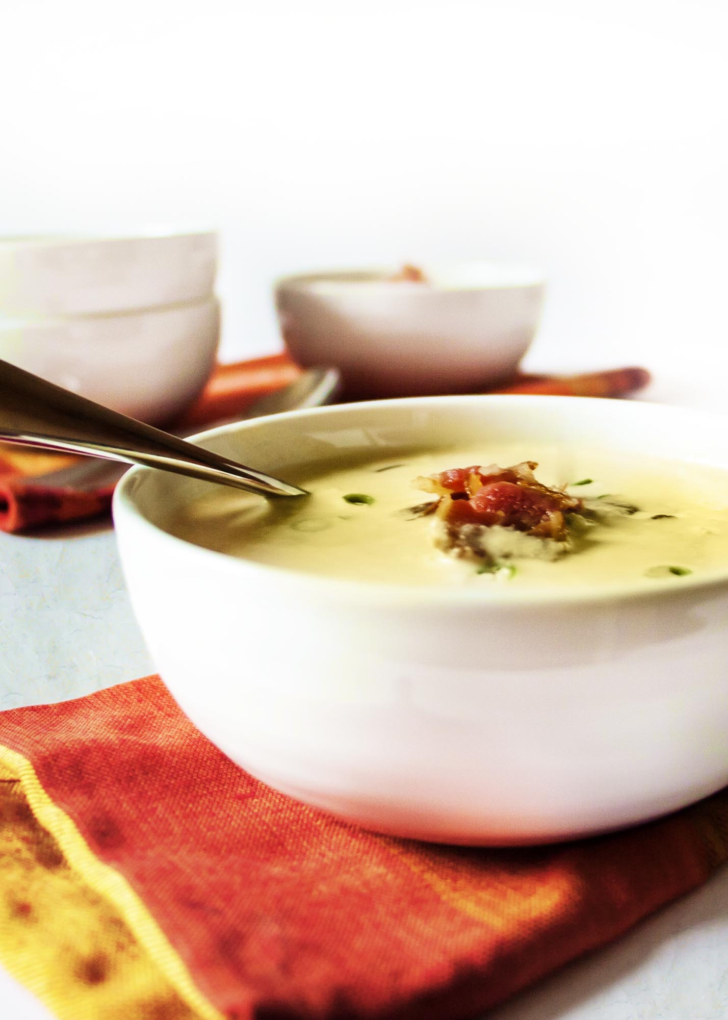 Silky Corn Soup Topped with Bacon - A stock made from corn cobs simmered with fresh, cut kernels create a soup full of corn flavor.   justalittlebitofbacon.com