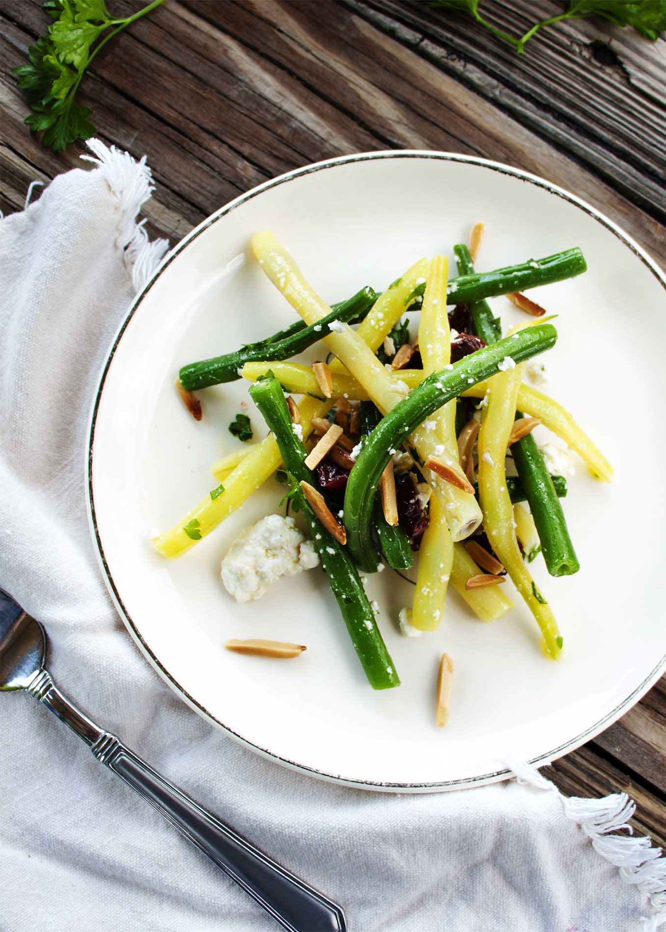Green Bean Salad with Goat Cheese and Almonds - This salad is the perfect balance of sweet, salty, and crunchy, all combined with tender green beans. It's the only green bean salad you will ever need. | justalittlebitofbacon.com