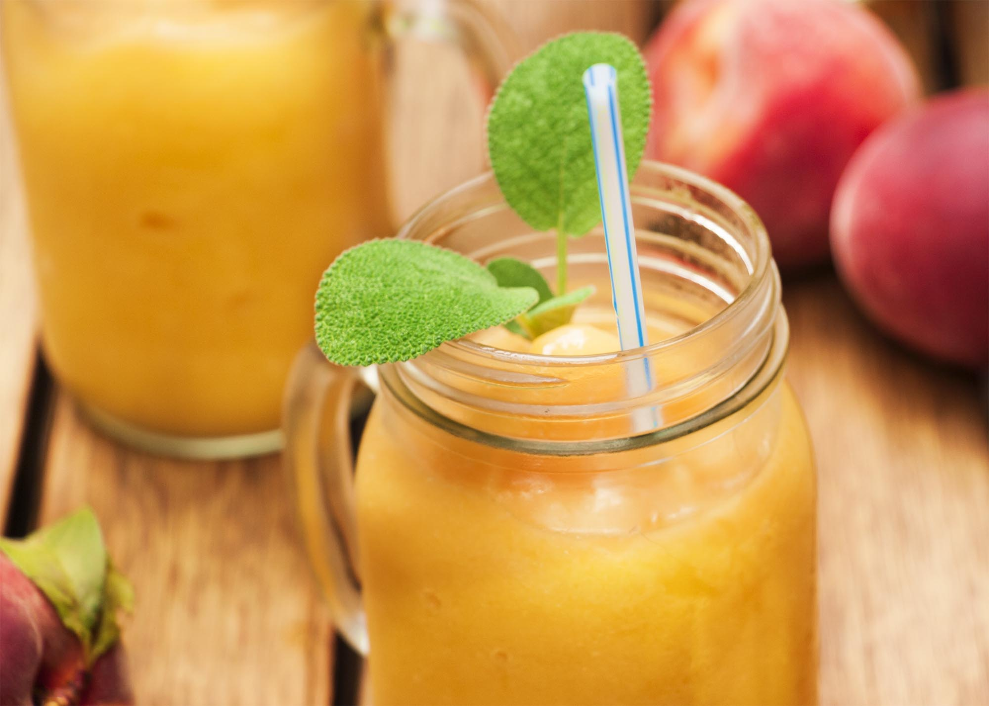 Peach Bourbon Frozen Cocktail with a hint of ginger - a sweet and spicy adult slushie that is the perfect end to a hot day | justalittlebitofbacon.com