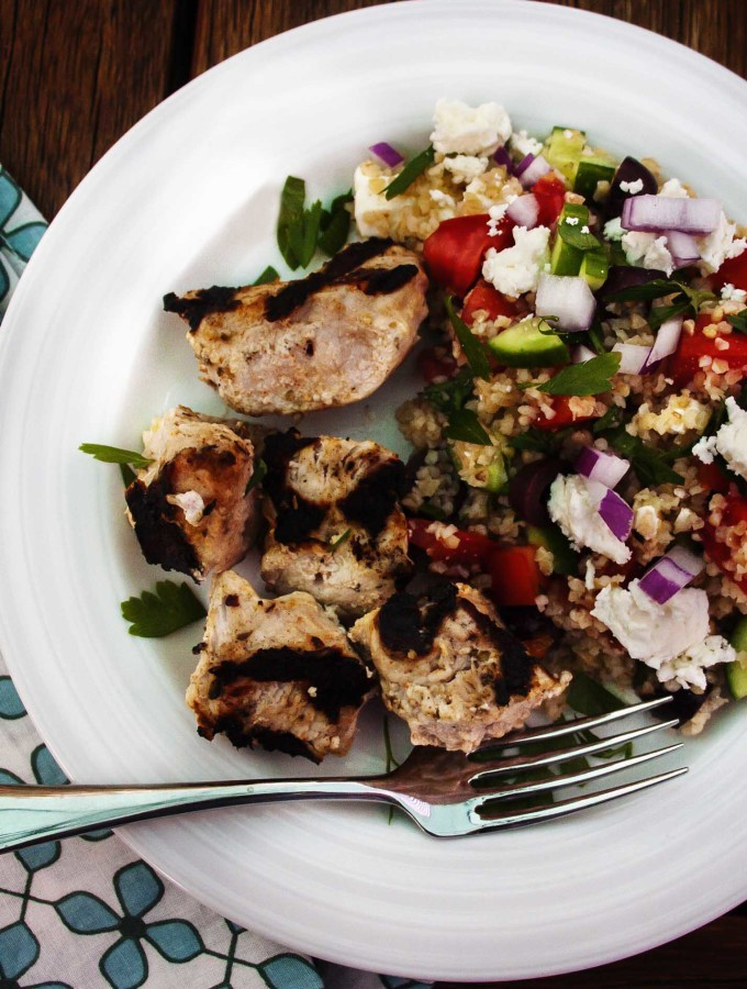 Pork Kebabs and Bulgur Salad - Pork skewers marinated in yogurt and spices match well with this hearty and fresh version of a Greek salad. | justalittlebitofbacon.com