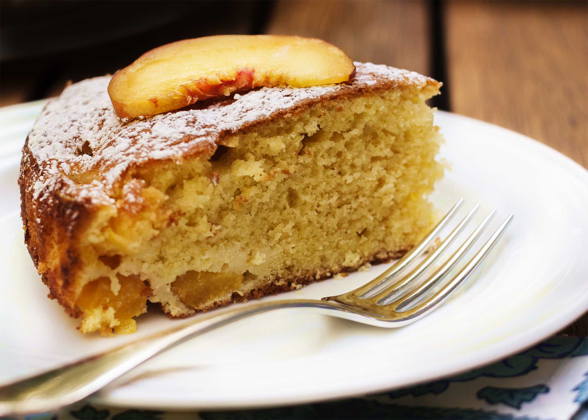 Summertime Peach Cake - Peaches, a hint of orange, and a cake which goes together in a snap and keeps for days   justalittlebitofbacon.com