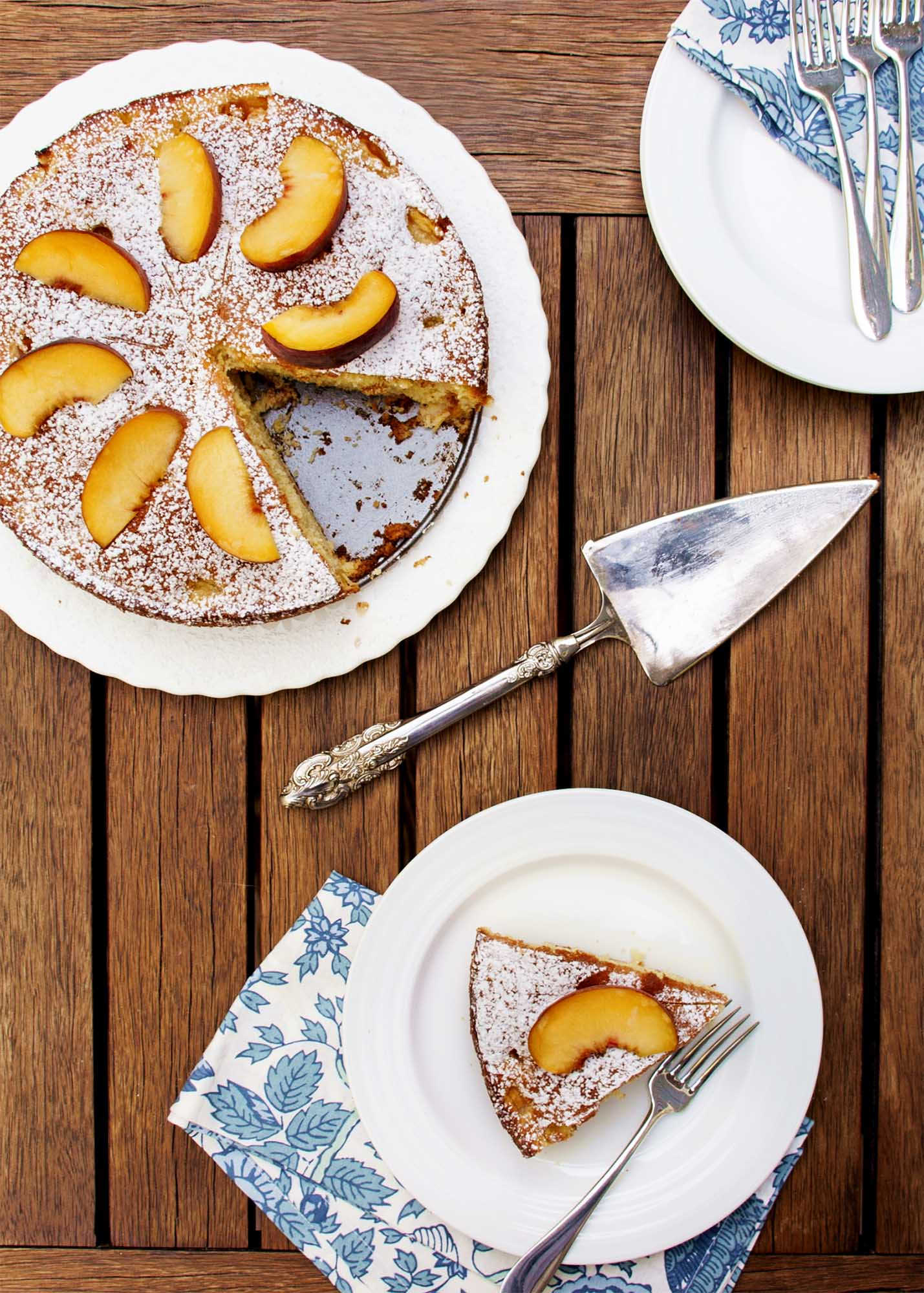 Summertime Peach Cake - Peaches, a hint of orange, and a cake which goes together in a snap and keeps for days | justalittlebitofbacon.com