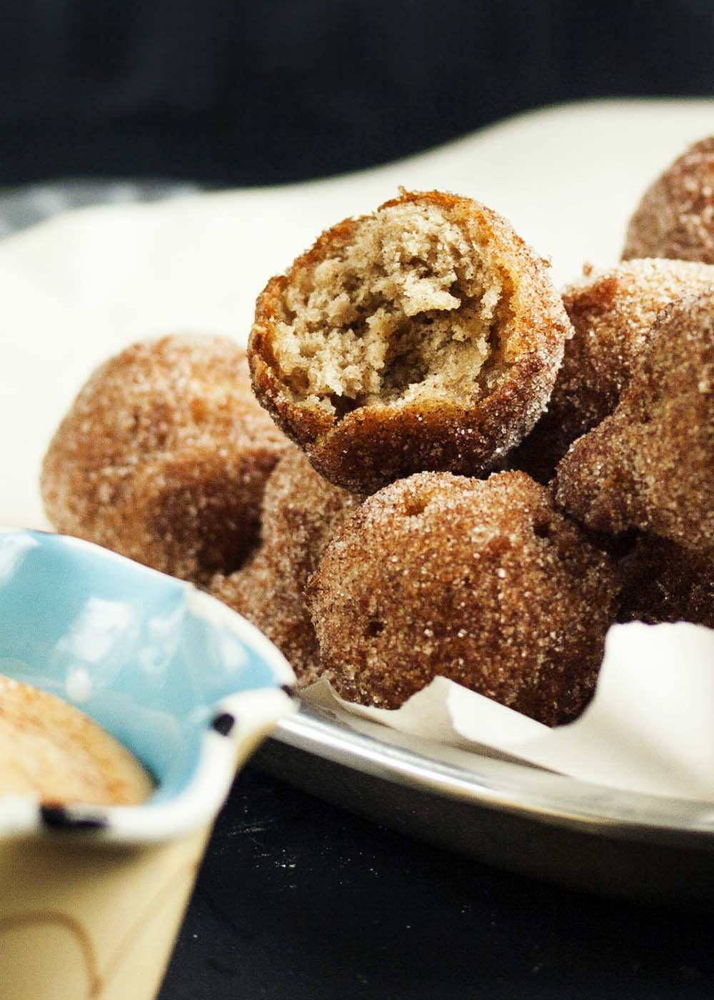 Cinnamon Sugar Apple Fritters - A snap to make, these apple fritters are little pillows of happiness full of chopped apples and covered in cinnamon sugar. And you just need one, little easy trick to turn out perfectly shaped fritters every time.   justalittlebitofbacon.com