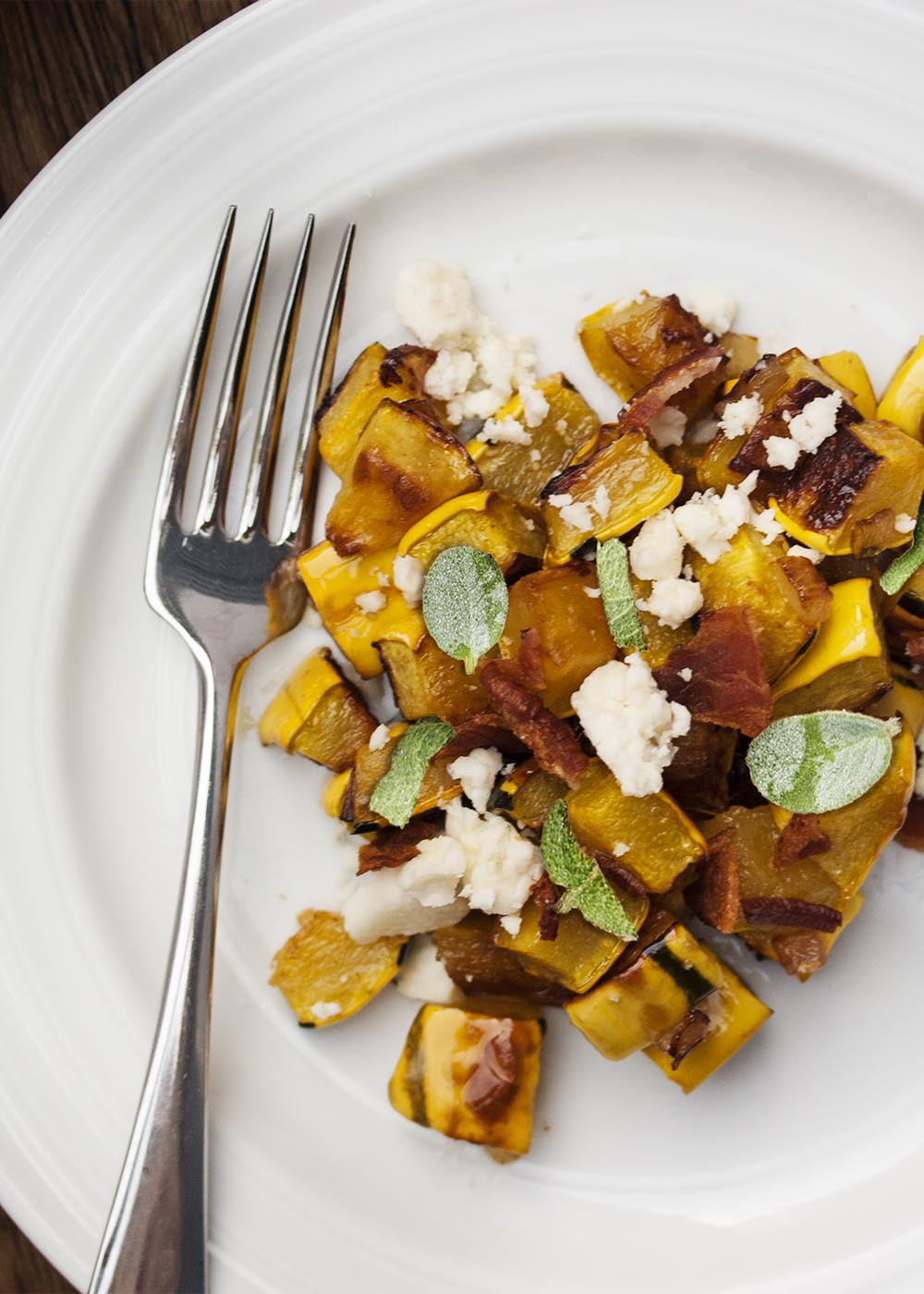 Delicata Squash With Bacon and Blue Cheese - Delicata squash is roasted and then tossed with bacon, blue cheese, and sage. I love it as a fall or Thanksgiving side dish. | justalittlebitofbacon.com