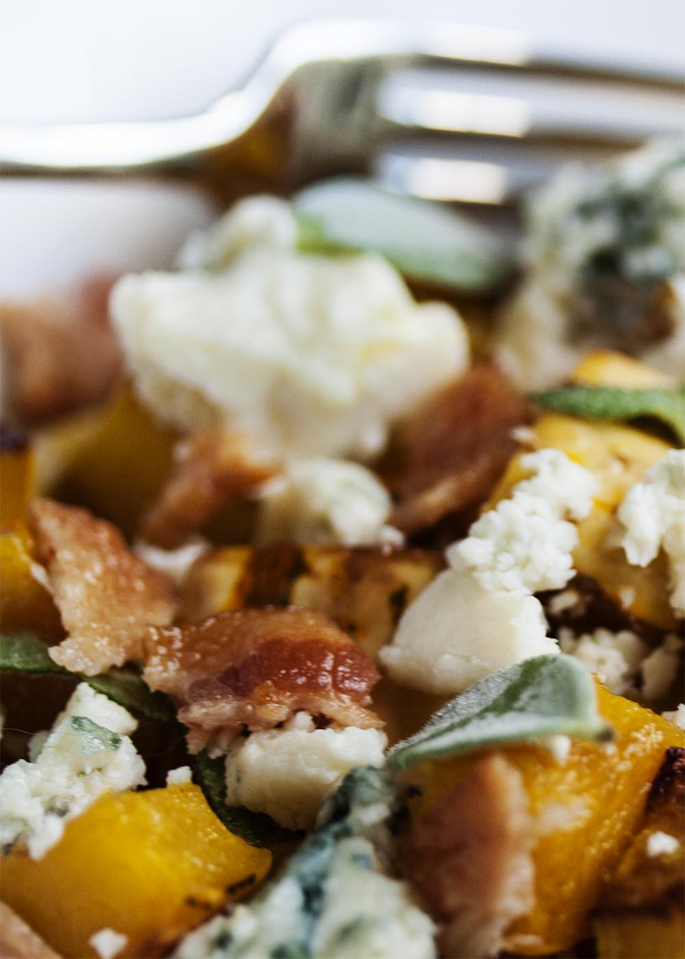 Delicata Squash With Bacon and Blue Cheese - Delicata squash is roasted and then tossed with bacon, blue cheese, and sage. I love it as a fall or Thanksgiving side dish.   justalittlebitofbacon.com