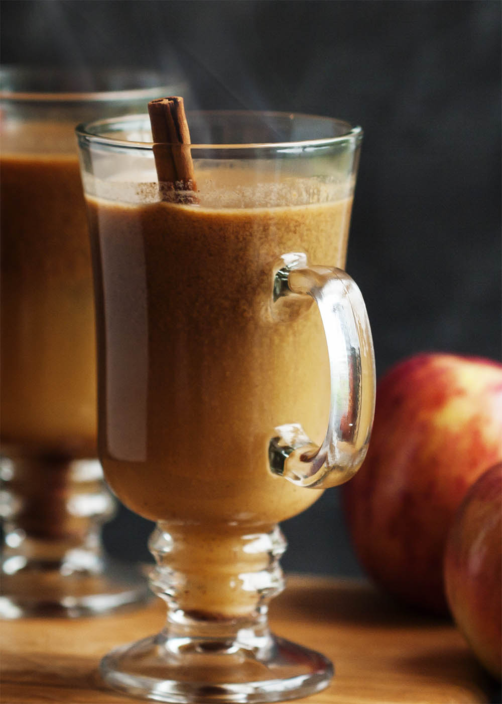 Hot Apple Pie Bourbon Cocktail - This twist on hot buttered bourbon uses cider and butterscotch sauce to make the perfect thanksgiving or fall cocktail. | justalittlebitofbacon.com