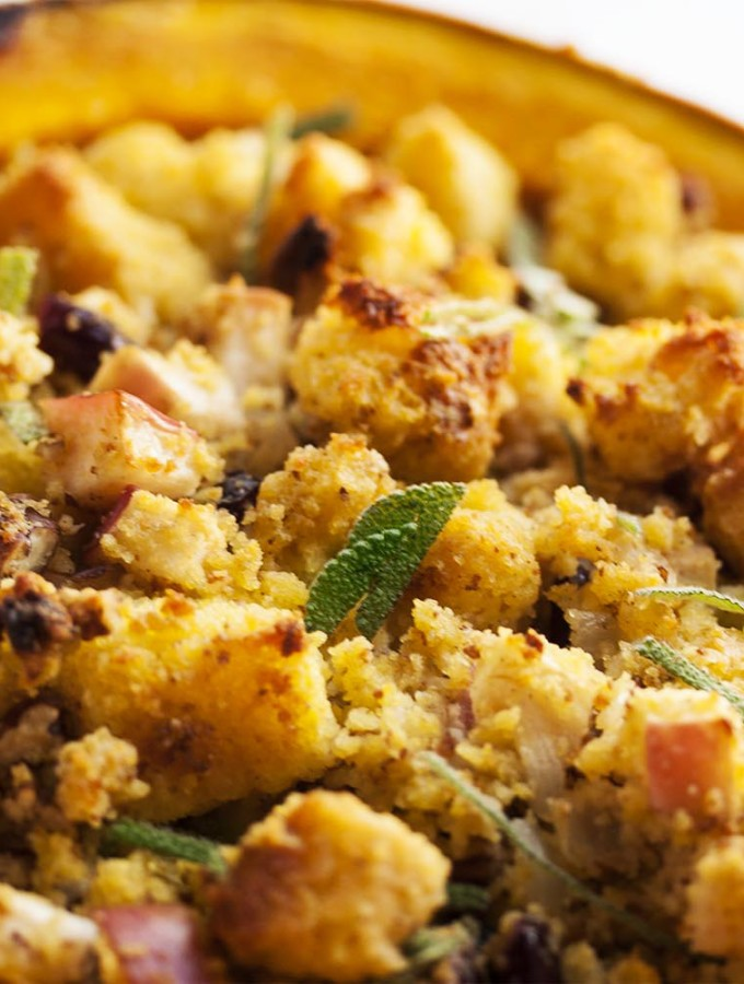 Hubbard Squash with Cornbread Stuffing - Looking for an impressive vegetarian centerpiece or side dish for your Thanksgiving table? Look no more! Filling a Hubbard squash with delicious cornbread stuffing is sure to produce oohs and ahhs. | justalittlebitofbacon.com