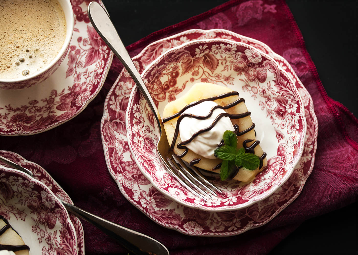 Poached Pears with Mascarpone Cream - These pears are poached in a spiced white wine syrup and then filled with mascarpone whipped cream and finished with a drizzle of bittersweet chocolate sauce. A wonderful way to end a holiday meal!   justalittlebitofbacon.com