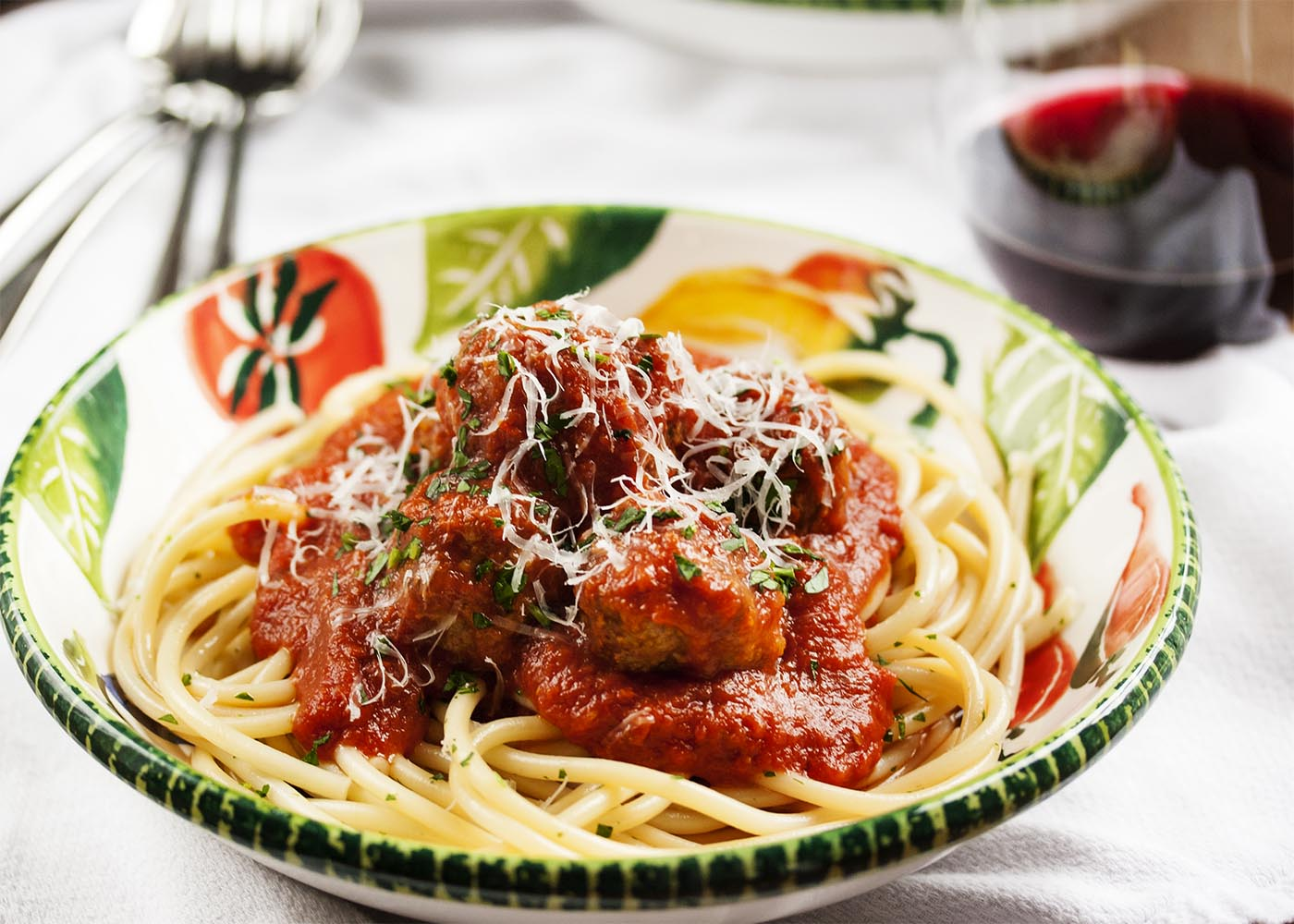 Braised Italian Meatballs - These classic meatballs from my Italian-American kitchen are packed with flavor and so tender from a long braising that they just about melt in your mouth. | justalittlebitofbacon.com