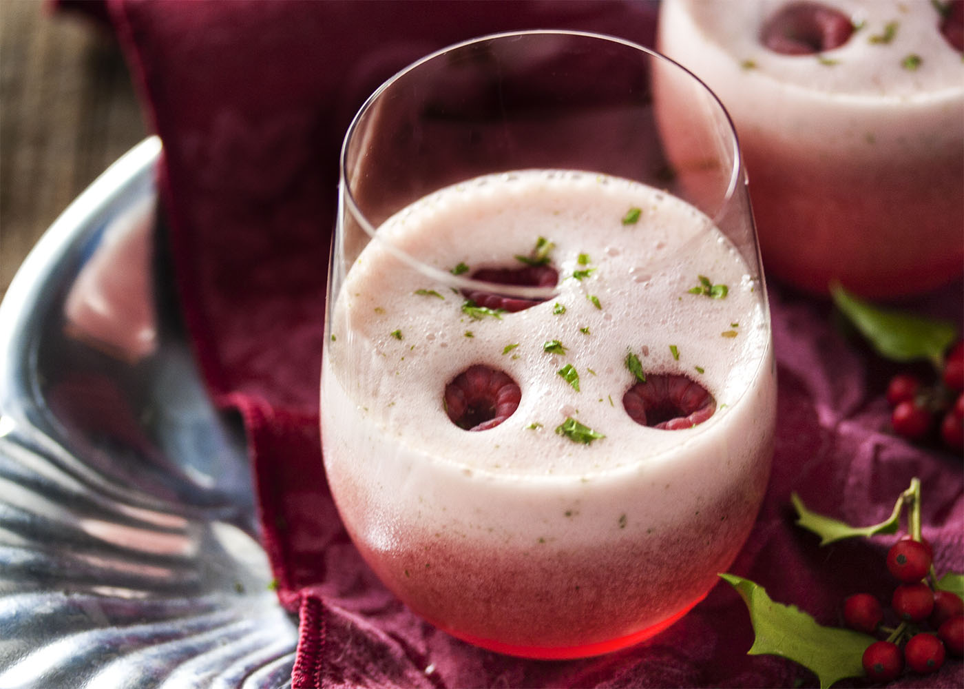 Raspberry Mint Prosecco Cocktail - Holiday entertaining is the time to bring out the bubbly and this prosecco sorbet cocktail is just the thing for a celebration. 5 minutes and 4 ingredients is all you need.   justalittlebitofbacon.com