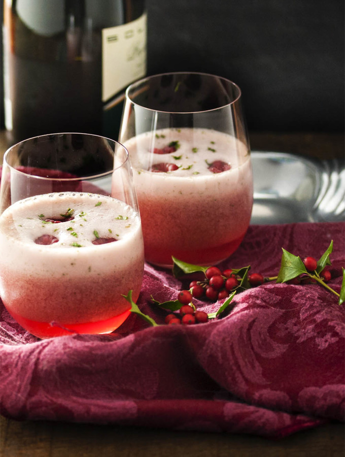 Raspberry Mint Prosecco Cocktail - Holiday entertaining is the time to bring out the bubbly and this prosecco sorbet cocktail is just the thing for a celebration. 5 minutes and 4 ingredients is all you need. | justalittlebitofbacon.com