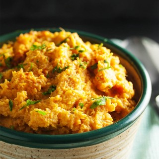 Chipotle Mashed Sweet Potatoes - Spicy, smoky chipotle in adobo sauce provides just the right amount smoky heat to balance out these creamy and buttery sweet potatoes. Excellent when paired with roasted or grilled meats!   justalittlebitofbacon.com