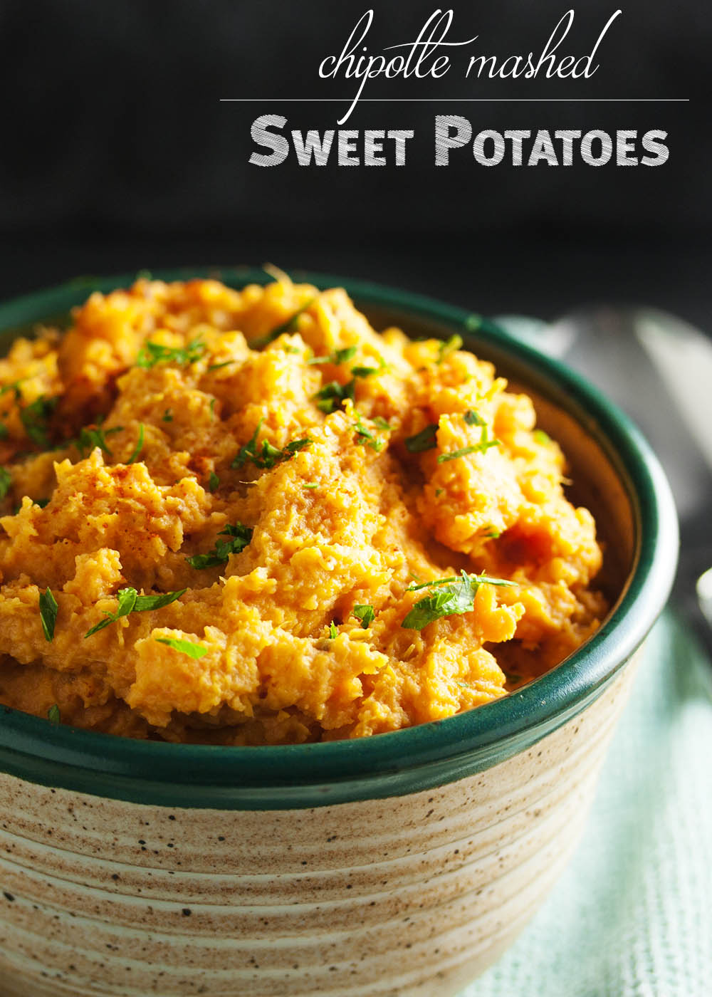 Chipotle Mashed Sweet Potatoes - Spicy, smoky chipotle in adobo sauce provides just the right amount smoky heat to balance out these creamy and buttery sweet potatoes. Excellent when paired with roasted or grilled meats! | justalittlebitofbacon.com