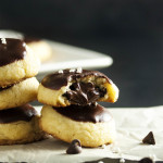 Chocolate Almond Stuffed Cookies - These chocolate covered cookies have a tender butter cookie outside and are filled with almonds and more chocolate! Just the thing to bring to a cookie exchange or to add to a cookie platter.   justalittlebitofbacon.com