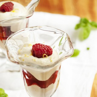 Raspberry Parfait with Ricotta Cream - In the mood for a healthy dessert that tastes like an indulgence? Creamy, lightly sweetened ricotta is layered with raspberries in this very easy and pretty parfait. | justalittlebitofbacon.com