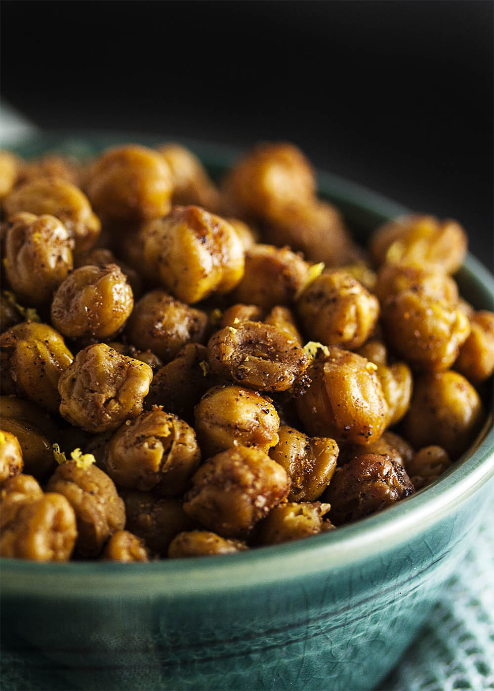 Spiced Dry Roasted Chickpeas - Dry roasting chickpeas produces an incredibly crunchy, tasty, and easy snack. And it's even healthy too! Just be careful - they're addictive. | justalittlebitofbacon.com