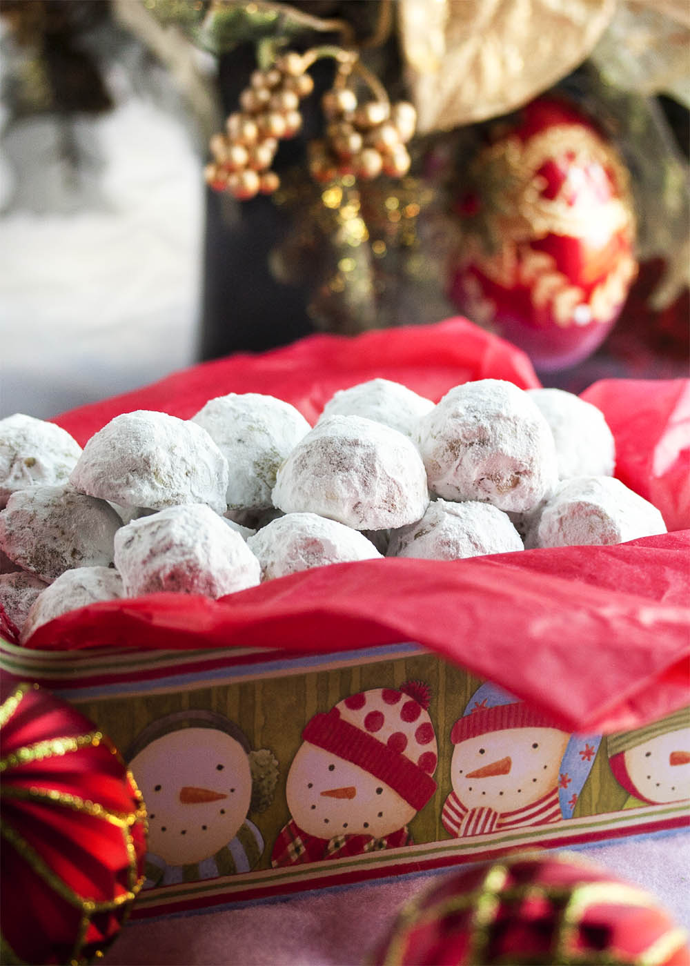 Pecan Snowball Cookies - These Pecan Snowball Cookies are melt-in-your-mouth tender, filled with ground and chopped pecans, and covered in powdered sugar. Whether you call them Snowballs or Russian Tea Cakes or Italian Wedding Cookies, it's not Christmas without them. | justalittlebitofbacon.com