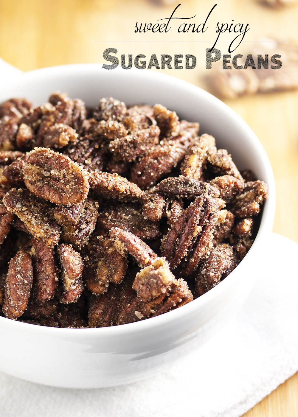 Sweet and Spicy Sugared Pecans - Just 10 minutes and you'll have this addictive sweet and spicy snack on hand. Sugared pecans are great for parties, for gifts, or simply for munching. | justalittlebitofbacon.com
