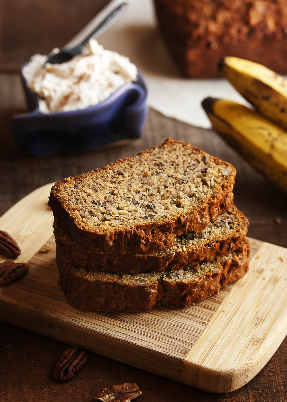 Bourbon Pecan Banana Bread - This bourbon pecan banana bread is a great basic banana bread! Dense and moist and full of lots of banana flavor, all enhanced with a dollop of bourbon. This is a recipe you will make again and again. | justalittlebitofbacon.com