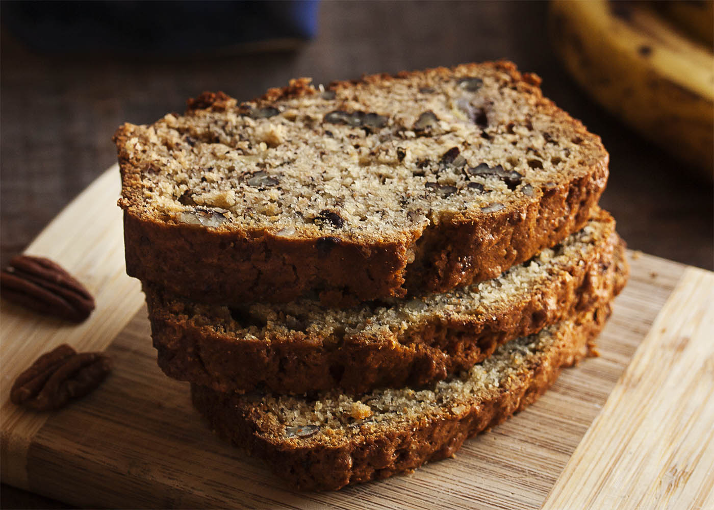 Bourbon Pecan Banana Bread - This bourbon pecan banana bread is a great basic banana bread! Dense and moist and full of lots of banana flavor, all enhanced with a dollop of bourbon. This is a recipe you will make again and again.   justalittlebitofbacon.com