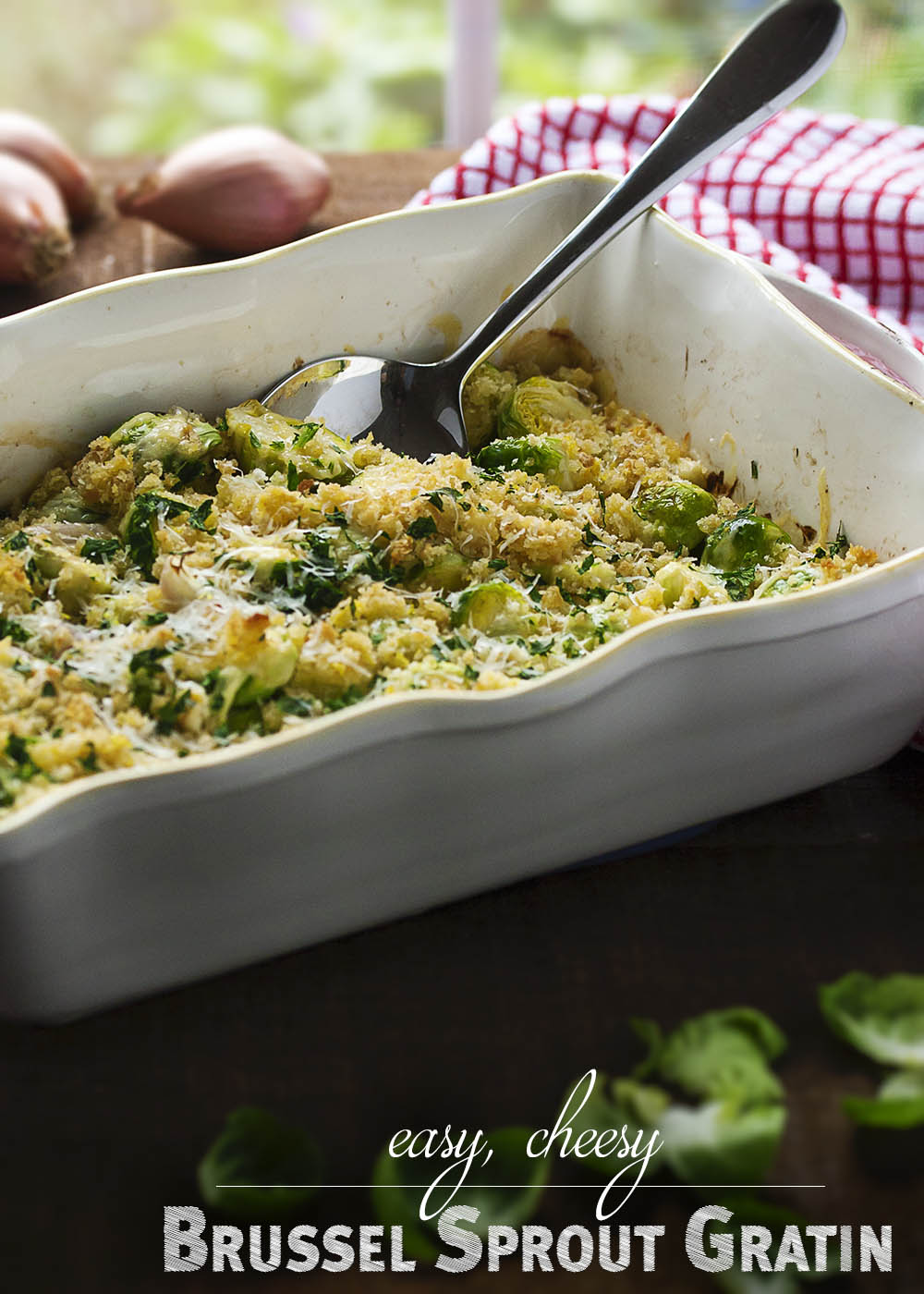 Easy Brussels Sprout and Shallot Gratin - In this brussel sprout gratin, brussel sprouts and shallots are roasted right in the casserole dish and then topped with cheese and breadcrumbs to make for an easy and light gratin. | justalittlebitofbacon.com