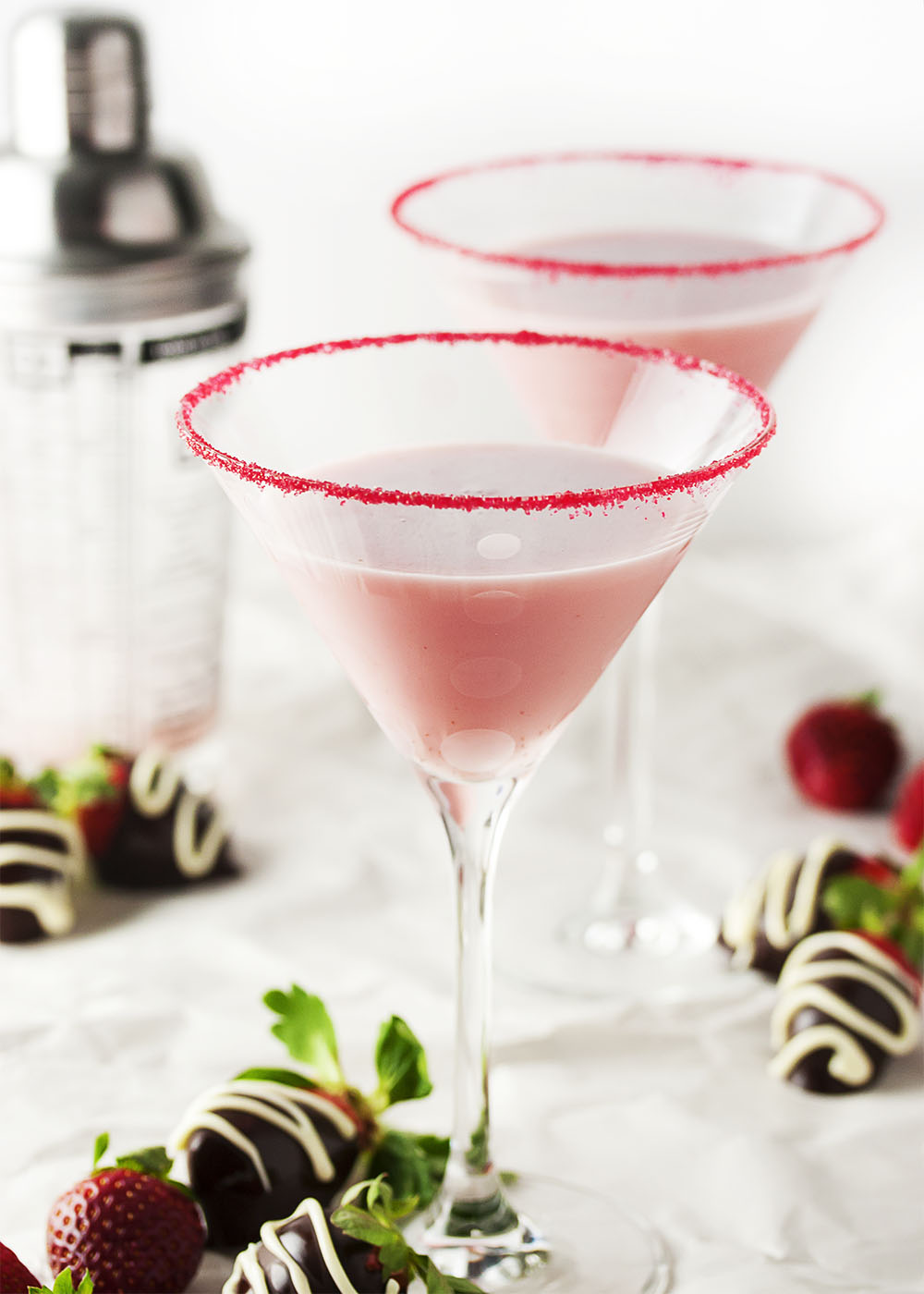 Chocolate Covered Strawberry Martini - Intense strawberry flavor is balanced with chocolate and a bit of cream which combine to make an amazing chocolate strawberry martini that is perfect for a romantic night in or a girl's night get-together. | justalittlebitofbacon.com