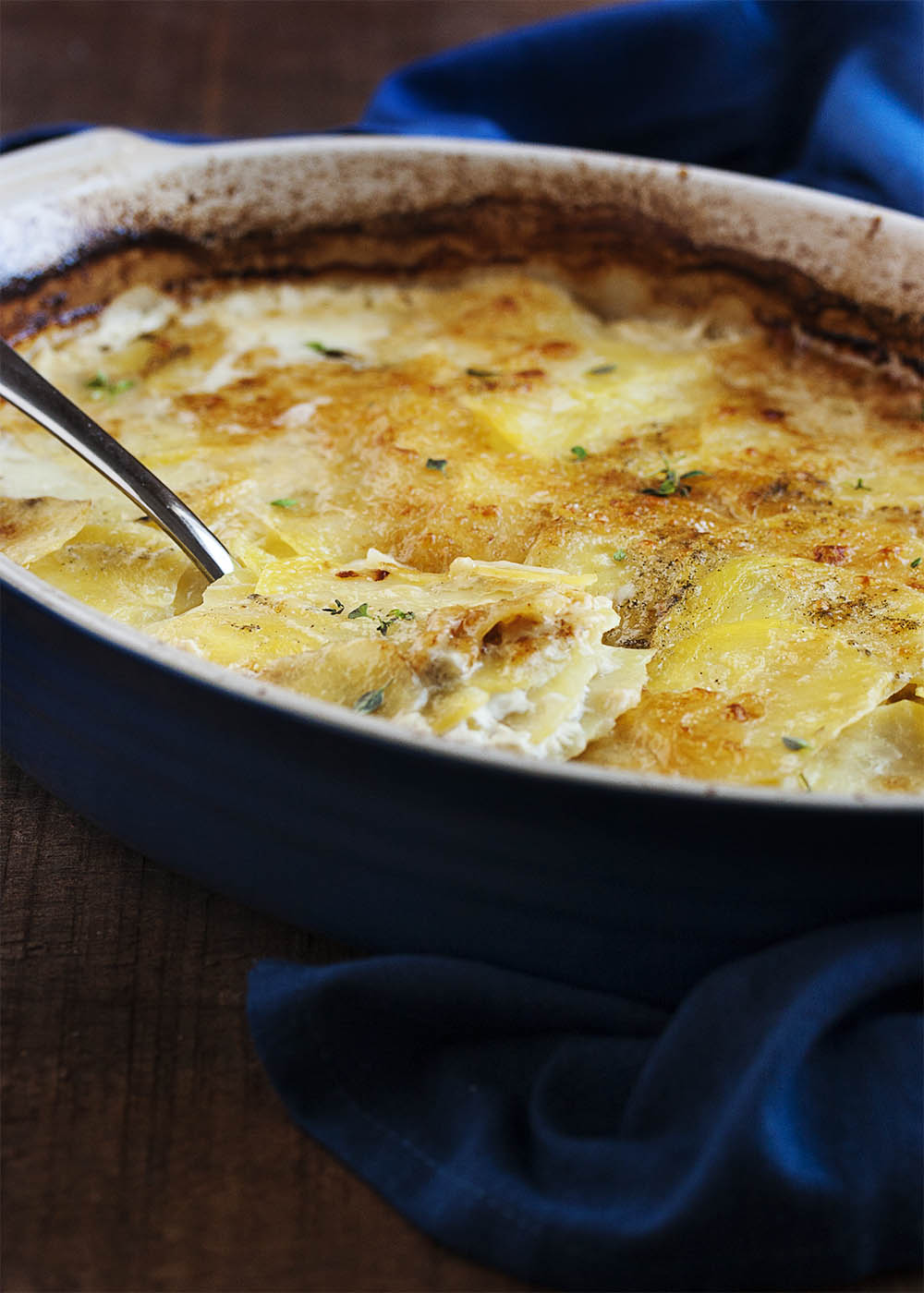 Classic Potato Gratin with Gruyere Cheese - In this classic and simple version of potato gratin, thinly sliced yellow potatoes alternate with layers of shredded gruyere, which is all bound together with garlic infused milk and baked to perfection.   justalittlebitofbacon.com