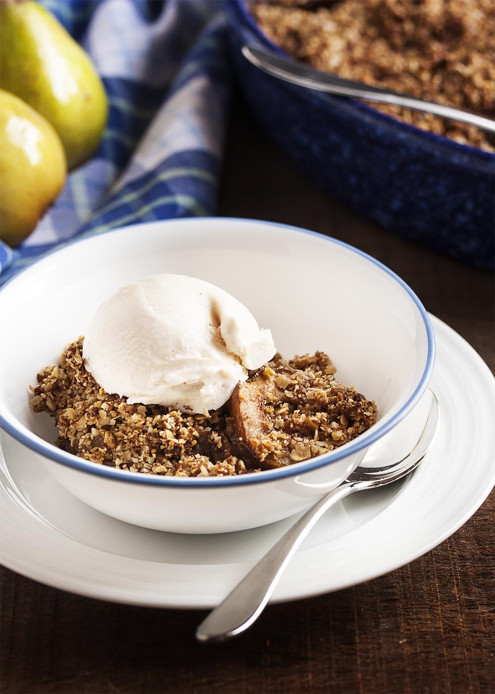 Gluten-Free Pear Ginger Crumble - Ripe pears and freshly grated ginger are topped with a nut and oat streusel in this lightly sweetened, gluten-free crumble. With no peeling necessary since the pears are sliced so thin! | justalittlebitofbacon.com