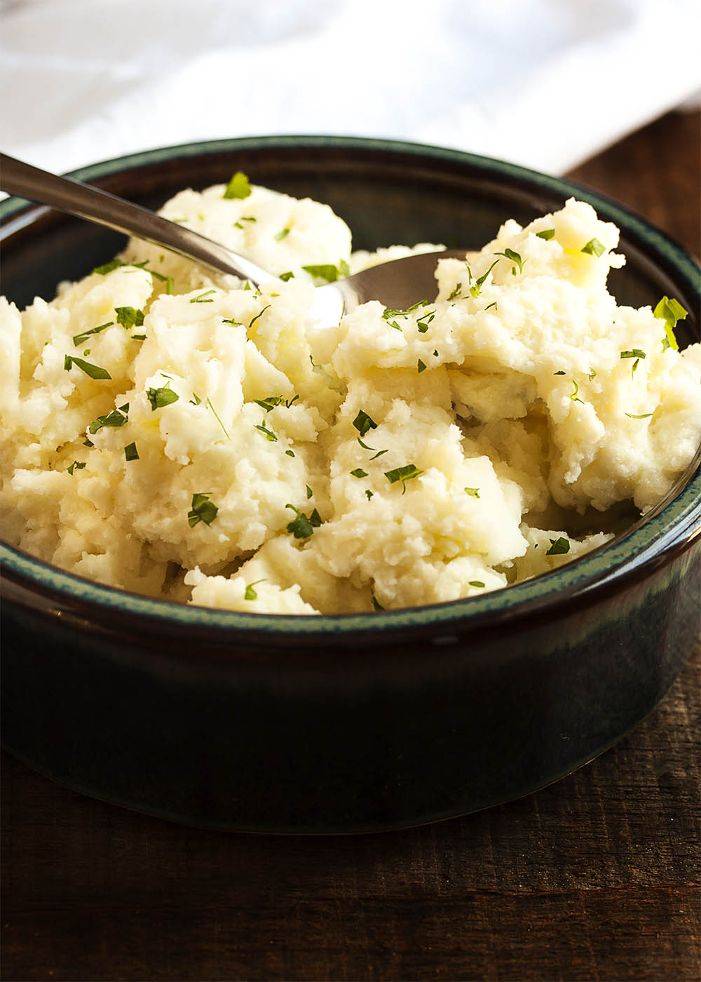 Cream Cheese Mashed Potatoes - Peeled yellow potatoes are simmered in salted water and then mashed with cream cheese and a splash of heavy cream in these amazingly tasty mashed potatoes. | justalittlebitofbacon.com