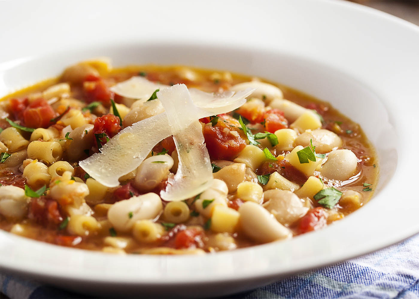 Pasta e Fagioli - Every Italian family has their own version of pasta and bean soup. Mine is light on the tomatoes, with plenty of pancetta, and a rich, flavorful broth. | justalittlebitofbacon.com