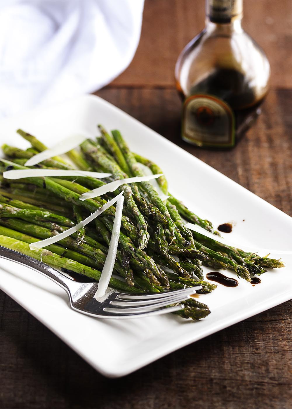 Roasted Asparagus with Parmesan and Balsamic - Asparagus is tossed with olive oil and parmesan before being roasted until crisp tender and then sprinkled with balsamic vinegar. An easy and flavorful side dish. | justalittlebitofbacon.com