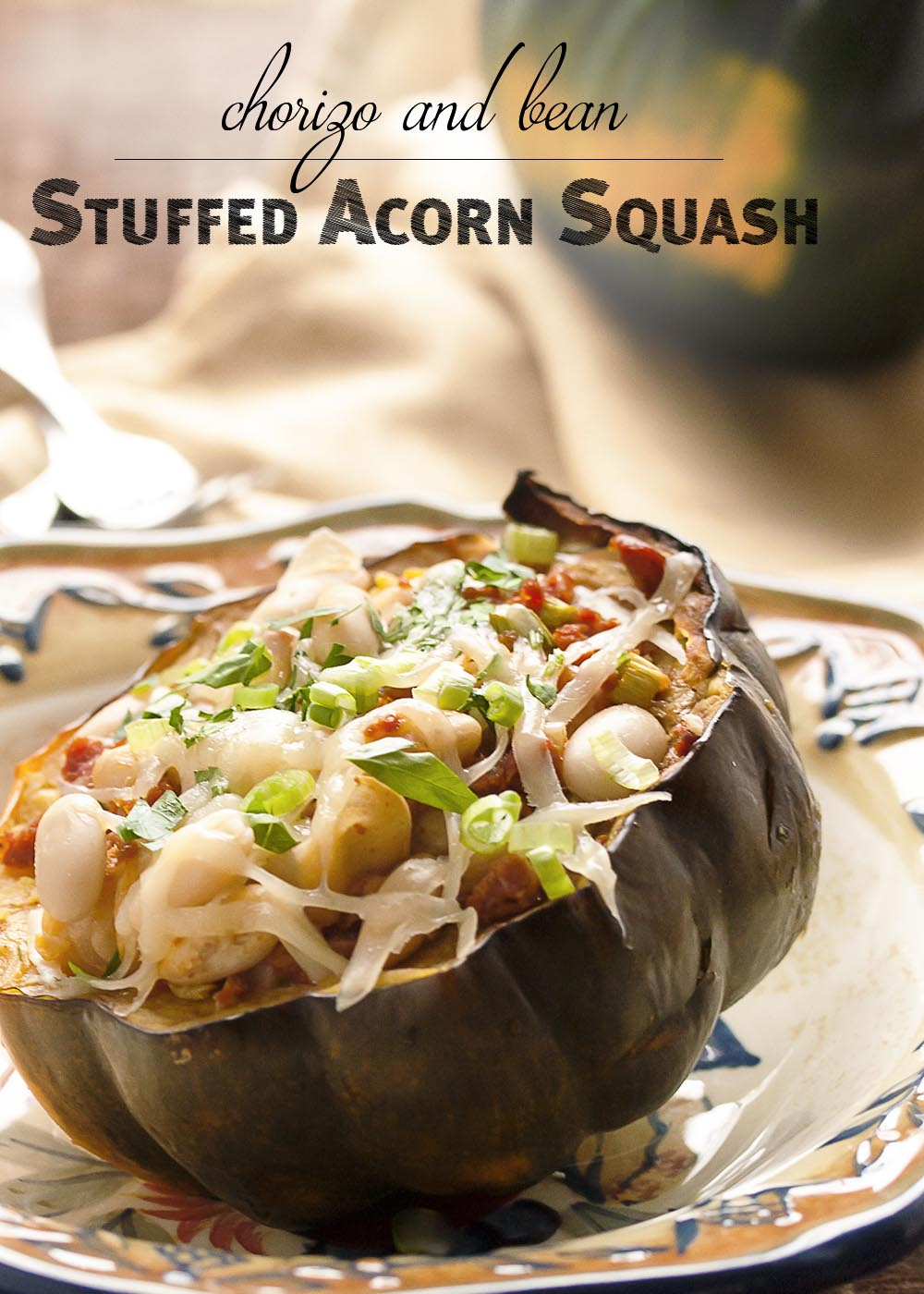 Acorn Squash Stuffed with Chorizo Sausage - Acorn squash is roasted and then filled with a delicious and flavorful mixture of chorizo, cannellini beans, and manchego to make a great, easy dinner. | justalittlebitofbacon.com