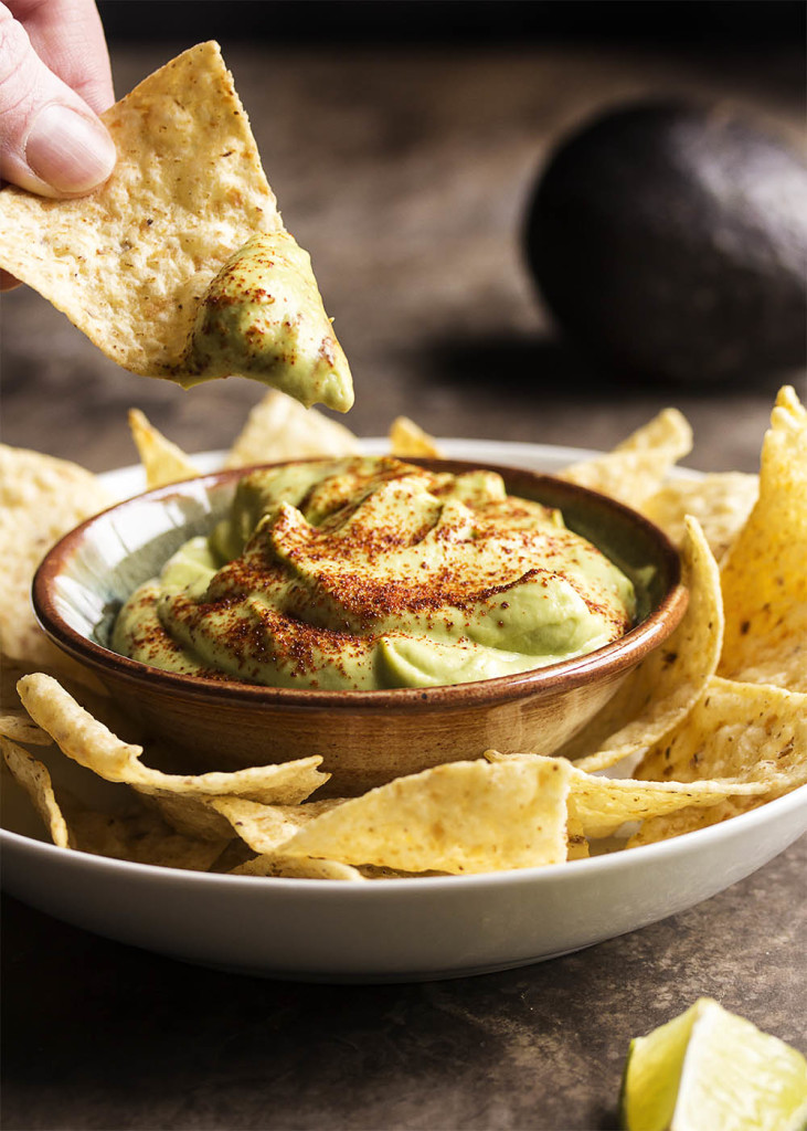 Tangy Lime Avocado Crema - Avocados are pureed with lime juice and a touch of sour cream in this Avocado Crema. Great as a taco topping, a sauce, or a dip!   justalittlebitofbacon.com