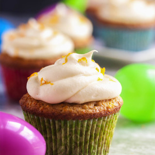 Moist Carrot Cake Cupcakes with Cream Cheese Frosting - Grinding up the carrots packs more carrots into each cupcake and makes these cupcakes extra moist and delicious! Creaming the butter and sugar together provides an extra tender crumb and a mostly flat top which is perfect for the lightly sweetened cream cheese frosting. | justalittlebitofbacon.com