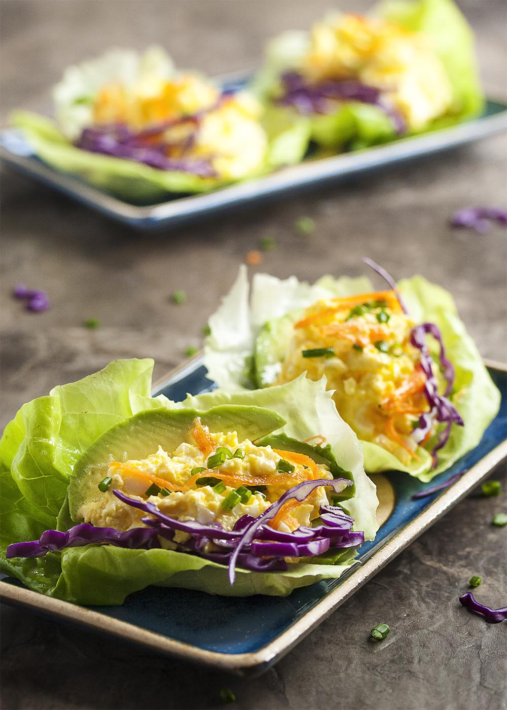 Avocado Egg Salad Lettuce Wraps - My favorite, simple egg salad recipe is paired here with avocado slices and wrapped in butter lettuce leaves. This is a wonderfully light and gluten-free way to enjoy egg salad. | justalittlebitofbacon.com