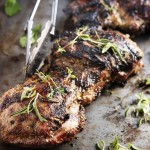Grilled Butterflied Leg of Lamb - Butterflied lamb is rubbed overnight with a flavorful herb and garlic mixture and then quickly grilled for a perfect dinner. It takes just 15 minutes to bring this roast to a beautifully seared outside and medium rare inside. Great for Easter dinner or for any cookout get-together. | justalittlebitofbacon.com