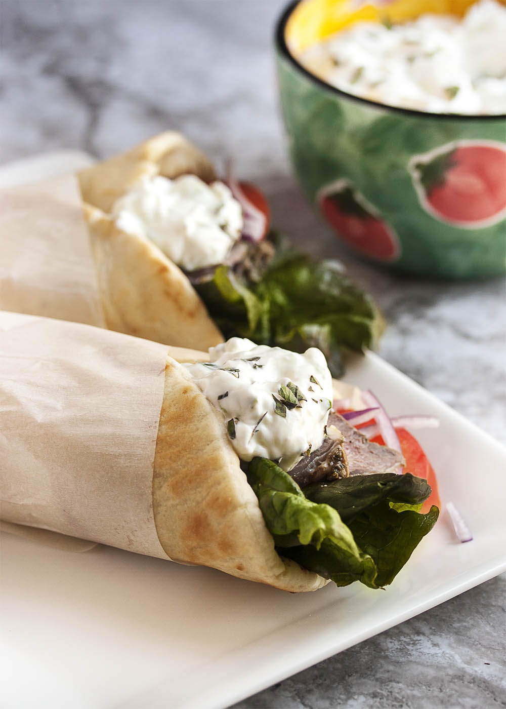 Leftover Lamb Gyros with Tzatziki Sauce - What to do with leftover lamb roast? Make these incredibly yummy lamb gyros and top them with a 5 minute tzatziki sauce.   justalittlebitofbacon.com