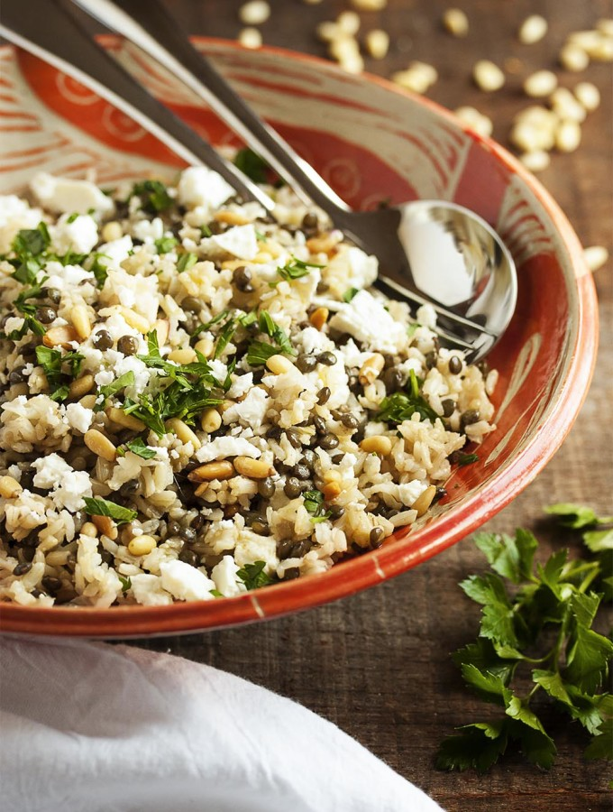 Brown Rice and Green Lentil Salad - This easy salad packs a big nutritional punch. Brown rice, green lentils, pine nuts, arugula and feta combine into a healthy and tasty side dish.   justalittlebitofbacon.com