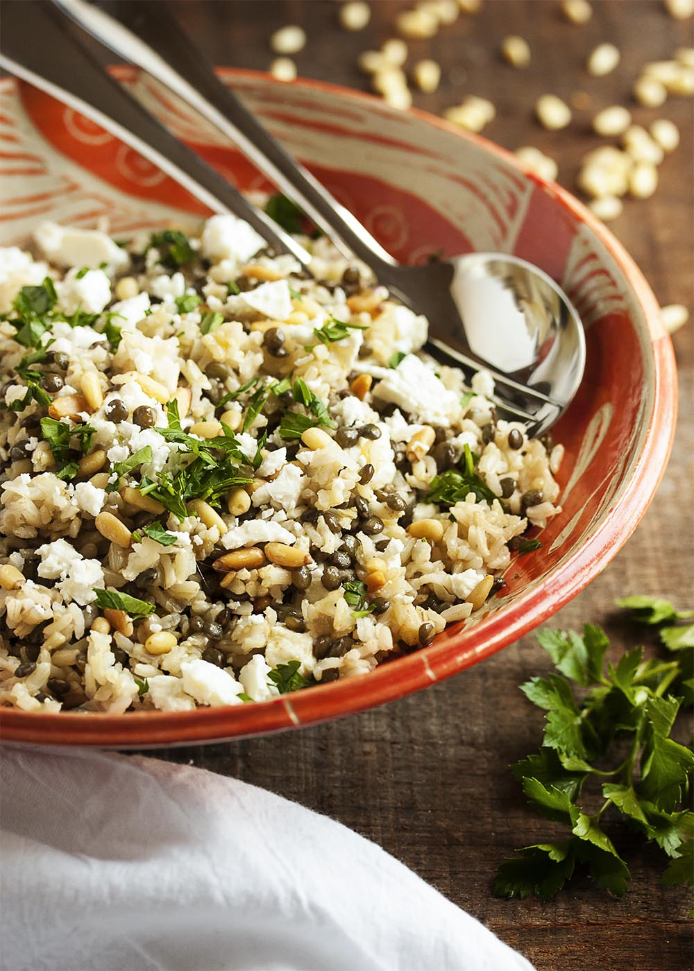 Brown Rice and Green Lentil Salad - This easy salad packs a big nutritional punch. Brown rice, green lentils, pine nuts, arugula and feta combine into a healthy and tasty side dish. | justalittlebitofbacon.com