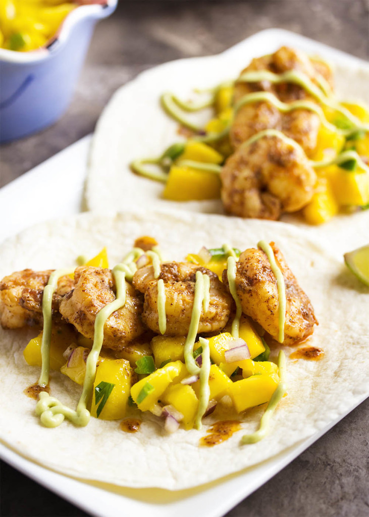Easy Shrimp and Mango Tacos - Spicy sauteed shrimp are paired with a quick and flavorful mango salsa in this recipe which will have dinner on the table in a flash.   justalittlebitofbacon.com