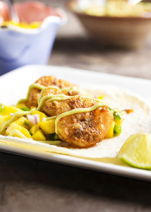 Easy Shrimp and Mango Tacos - Spicy sauteed shrimp are paired with a quick and flavorful mango salsa in this recipe which will have dinner on the table in a flash. | justalittlebitofbacon.com
