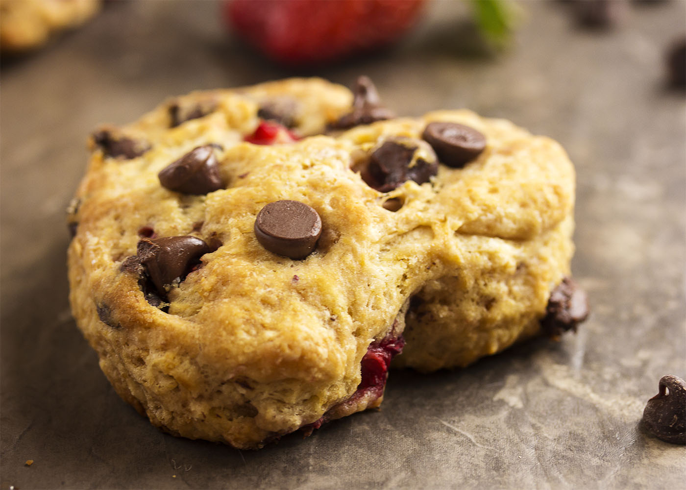 Close up of a heart shaped chocolate chip strawberry buttermilk scone.