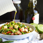 Toasted Corn and Edamame Salad - Quick, healthy and flavorful! Toasted corn, creamy cheese, spicy scallions, and yummy edamame all tossed with a honey lime dressing will have you going back for seconds. Perfect for a summer picnic or cookout. | justalittlebitofbacon.com
