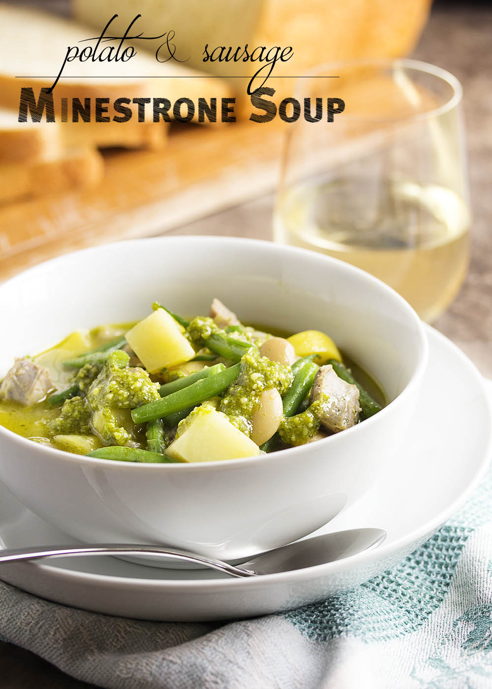 Potato and Sausage Minestrone Soup - An easy and classic minestrone soup filled with pesto, potatoes, vegetables, beans, and sausage. Even better the next day! Serve it with some crusty bread to dip in the the flavorful broth. | justalittlebitofbacon.com