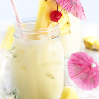 My Perfect Pina Colada - My pina colada has plenty of pineapple flavor, lots of smooth coconut, and not too much sugar. Perfect for sipping on a warm day! Serve it over ice and think about summer. | justalittlebitofbacon.com