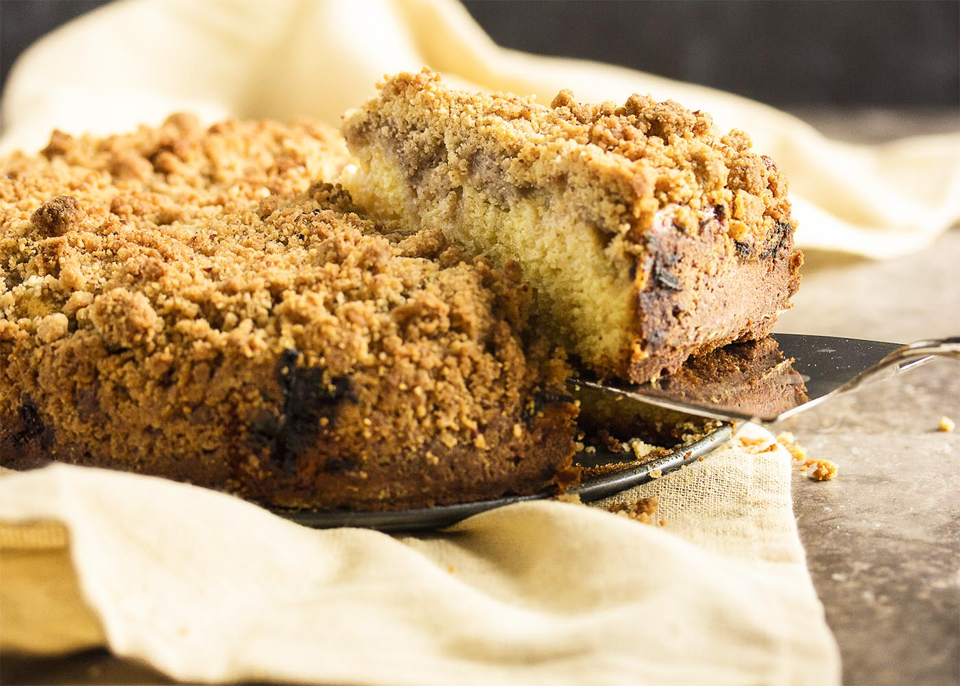 Rhubarb Coffee Cake with Crumb Topping - Spring is here with this rhubarb coffee cake, which has a tart layer of rhubarb sandwiched between soft cake on the bottom and crumb topping above. A little sweet, a little tart, and all yummy! | justalittlebitofbacon.com