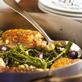 Pan Roasted Chicken Thighs with Olives and Pine Nuts - The crispy, crackling skin and juicy, flavorful meat on these chicken thighs is paired with salty olives and creamy pine nuts in this easy main dish. Add a bunch of broccolini, and you have dinner! | justalittlebitofbacon.com